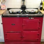 Aga cleaning. 3 door oven in dark red.
